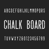 Retro chalk board alphabet font. Letters and numbers on a dark background. Vector typeface for your design Stock Illustration