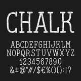Retro chalk board alphabet font. Letters and numbers and symbols. Stock Image