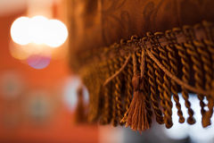 Retro chandelier. With a shade of fabric stock photography