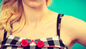 Retro checked dress with red buttons Royalty Free Stock Images