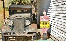 Retro chevrolet truck with retro road sign Royalty Free Stock Photos