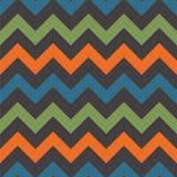 Retro Chevron Seamless Pattern. Vintage zig zag chevron seamless pattern in retro colors of green, orange, blue, and gray inspired by 1970s Royalty Free Stock Photos