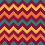 Retro Chevron Seamless Pattern. Vintage zig zag chevron seamless pattern in retro colors of orange, blue, and red inspired by 1970s Royalty Free Stock Photography