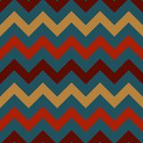 Retro Chevron Seamless Pattern. Vintage zig zag chevron seamless pattern in retro colors of orange, red, maroon, and blue inspired by 1970s Royalty Free Stock Photography