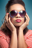 Retro chik. Young beautiful woman wearing vintage sunglasses Stock Images
