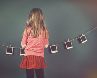 Retro Child Hanging Vintage Photo Film on Wall Stock Photo