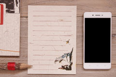 Retro Chinese aboriginal stock photography flat lay vintage pape. R note message wooden plank pencil smart phone mock up Stock Image