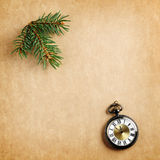 Retro christmas background with antique watch. And branch of christmas tree Stock Photography