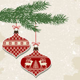 Retro christmas balls with ornaments. Christmas balls with nordic cross stitch ornament and green branch Royalty Free Stock Image