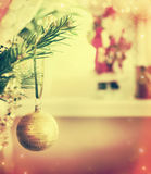 Retro Christmas bauble on tree over room decoration Royalty Free Stock Photos