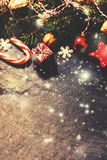 Retro Christmas Card with decorations on dark background in vint. Age style. Toned filter effect Stock Photography