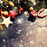 Retro Christmas Card with decorations on dark background in vint. Age style. Toned filter effect Stock Photo