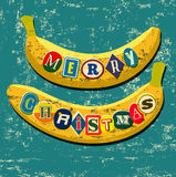 Retro Christmas card design. Two banana with stickers. Typographic grunge vector illustration. Stock Photo