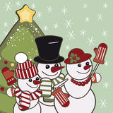 Retro Christmas card with a family of snowmen. Royalty Free Stock Image