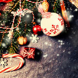 Retro Christmas decorations on dark background in vintage style. Stock Photo