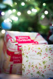 Retro christmas gifts. Some presents lie under a christmas tree Royalty Free Stock Photo