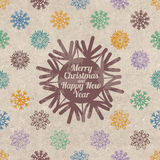 Retro Christmas greeting card with snowflakes Stock Photos