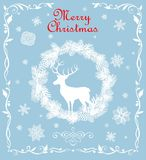 Retro Christmas greeting pastel blue card with cut out paper fir wreath, snowflakes and deer. Retro Christmas greeting pastel blue card with cut out paper fir Stock Images