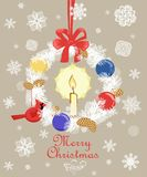 Retro Christmas greeting card with cut out paper fir wreath, gold fir tree cone, candle, snowflakes, hanging northern cardinal bir. Retro Christmas greeting Stock Photography