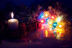 Retro christmas ligts and candle Stock Images