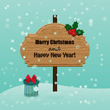 Retro Christmas and New Year greetings card. Wooden signboard wi Royalty Free Stock Photo