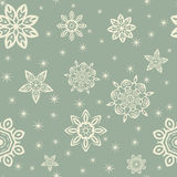 Retro Christmas pattern with white snowflakes on blue background. Vintage Color Royalty Free Stock Photos
