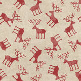 Retro Christmas seamless pattern with funny deers. On a vintage cardboard background Royalty Free Stock Images
