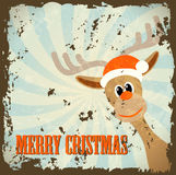 Retro christmas theme with reindeer and text merry Stock Images