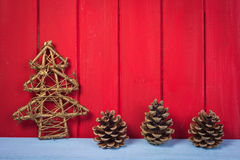 Retro Christmas tree pine cone  on red wood background Stock Photography