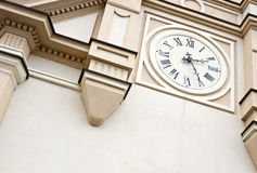 Retro church clock. White retro church clock on a wall stock images