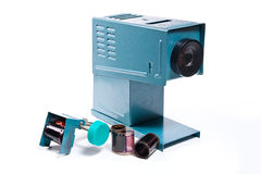 Retro cine-projector on the white background. Stock Image