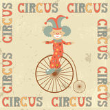 Retro circus poster with clown. On retro bicycle Royalty Free Stock Photos
