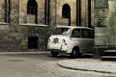 Retro city car. On first view I haven't surety where is front and where back is :-) It was funny ... Photo was stylized to aged look & feel Royalty Free Stock Image