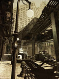 Retro city. Digital recreation of a city  inspired on  Manhattan  as it was in the forties of the twentieth century, over grunge background. Street view under Stock Image