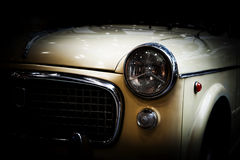 Retro classic car on black background. Vintage, elegant Royalty Free Stock Photos