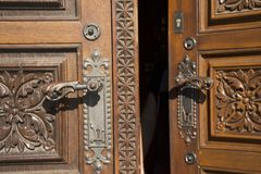 Retro classic wooden door and anitque lock door old style of Church of St. Ludmila. At namesti miru or Peace Square in Prague, Czech Republic Royalty Free Stock Images