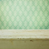 Retro classical wallpaper and wooden table Royalty Free Stock Image