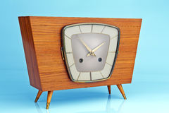 Retro clock. On a background of vintage wallpaper Royalty Free Stock Images
