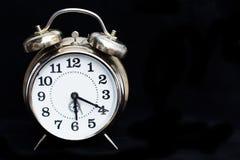 Retro clock on black background Stock Images