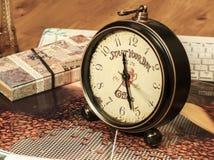 Retro Clock. A blown retro clock on the table Stock Photos