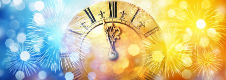 Retro clock close to midnight, fireworks and lights. New Year`s and Christmas background stock photography