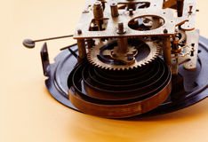 Retro clock mechanism, bronze cog wheels macro view. Shallow depth of field, selective focus. Royalty Free Stock Image