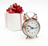 A retro clock with presents Royalty Free Stock Images