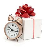 A retro clock with presents Stock Photos