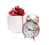 A retro clock with presents Royalty Free Stock Photos