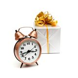 A retro clock with presents Stock Images