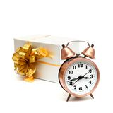 A retro clock with presents Stock Photography