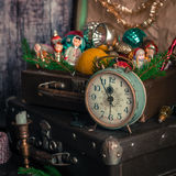 Retro Clock, Suitcases, Christmas Tree Decorations. Retro Alarm Clock, Vintage Leather Suitcases, Old Fashioned Christmas Tree Decorations, square Stock Photo