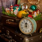 Retro Clock, Suitcases, Christmas Tree Decorations. Retro Alarm Clock, Vintage Leather Suitcases, Old Fashioned Christmas Tree Decorations, square Stock Photography