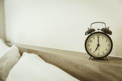 Retro clock times 7 o`clock in the bedroom royalty free stock photo